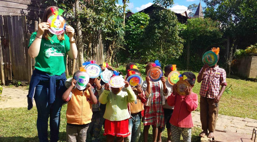A Projects Abroad volunteer plays with children in Madagascar during a summer camp.